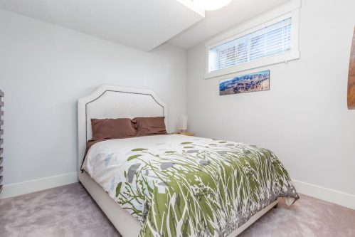 basement-bedroom-flower-bedspread-3514-42-Street-SW-Glenbrook-Calgary-Home-Real-Estate-for-sale-infill-attached-Plintz