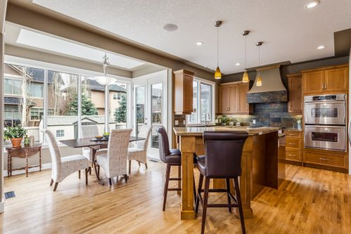 Open concept kitchen dining at 236 Evergreen Plaza SW.
