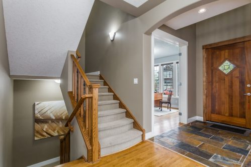Entry staircase and foyer in home for sale by Plintz Real Estate.