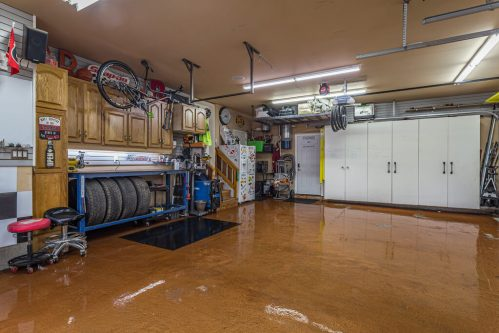 Triple attached garage with epoxy finish in 236 Evergreen Plaza SW in Calgary.