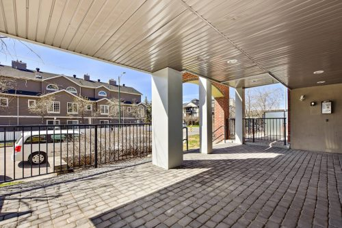 Covered courtyard with paving stone 304 1108 15 Street SW Condo for sale in Sunalta Calgary