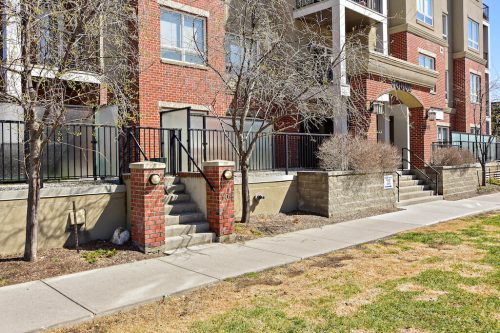 Brick exterior of lowrise 304 1108 15 Street SW Condo for sale in Sunalta Calgary