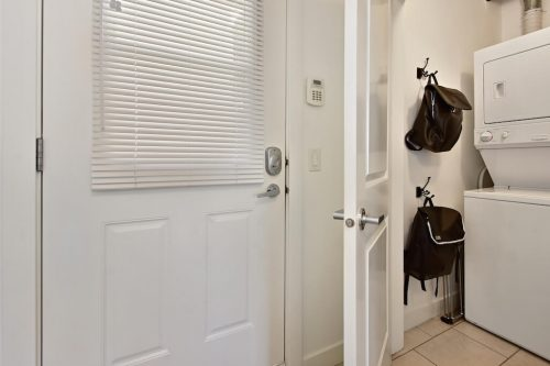 In-suite laundry with stacking washer dryer at 304 1108 15 Street SW Condo for sale in Sunalta Calgary