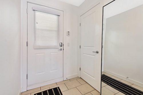 White condo entry door 304 1108 15 Street SW Condo for sale in Calgary