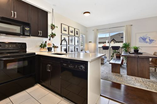 Open layout kitchen dining room 304 1108 15 Street SW Condo for sale in Sunalta Calgary
