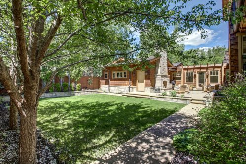Backyard in summer of a Rideau Park luxury Calgary home for sale by Plintz Real Estate.