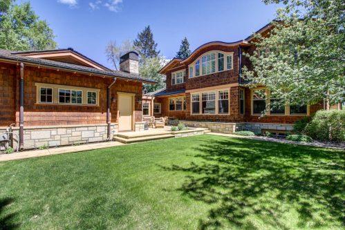 backyard-patio-fireplace-stone-cedar-winter-3015-5-Street-SW-Rideau-Calgary-Homes-For-Sale-Plintz-Real-Estate