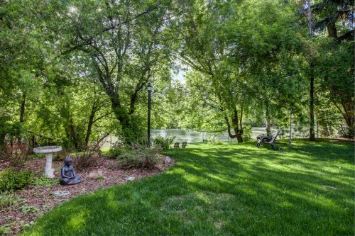 Backyard oasis in Rideau Park overlooking the Elbow River in Summer Calgary