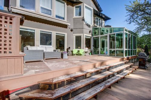 Backyard patio with sunroom overlooking the Elbow River in Rideau Calgary Alberta House For Sale by Plintz Real Estate
