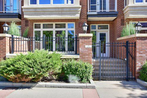 Unit 102 street access brick Cityscape Executive Condo Eau Claire Calgary Plintz Real Estate For Sale