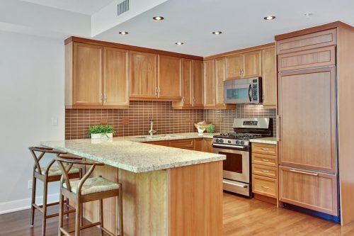 Kitchen with breakfast counter Cityscape Executive Condo Eau Claire Calgary Plintz Real Estate For Sale