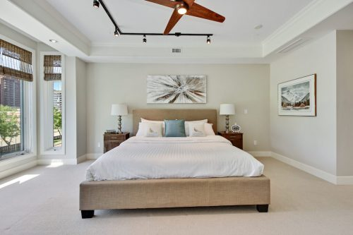 Modern master bedroom Cityscape Executive Condo Eau Claire Calgary Plintz Real Estate For Sale