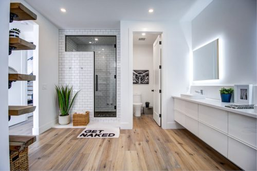 Steam shower with get naked floor mat in ultra modern luxury home in Calgary for sale.
