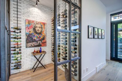 Glass and brick wine cellar in luxury home.