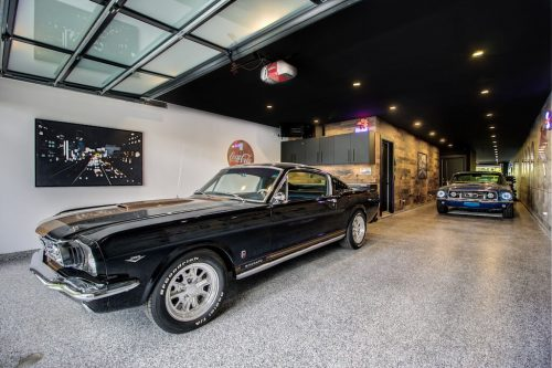 Luxury triple garage with classic car in Bridgeland Calgary luxury home for sale by Plintz Real Estate