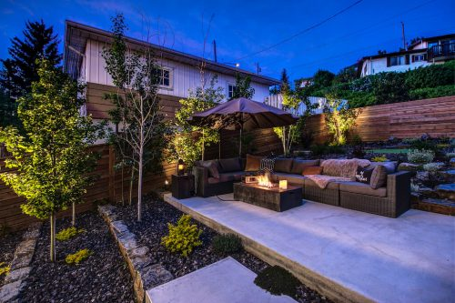 Backyard terraced landscaping in Bridgeland Calgary luxury home.