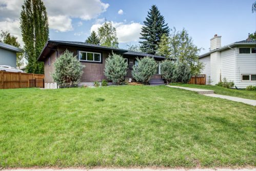 Bungalow with trees and lawn in Haysboro Calgary