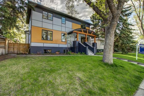 Cedar-stucco-trees-landscaping-3119-Kilkenny-Drive-SW-Killarney-Calgary-Real-Estate-Homes-For-Sale-Plintz-Realtor-Dennis