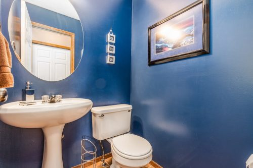 Blue powder room with pedestal sink 47 Valley Creek Bay NW Calgary house for sale