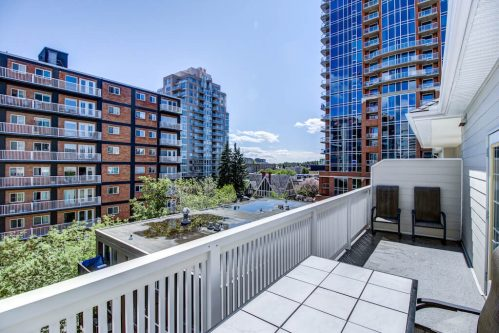 Patio with view of other condo buildings in Calgary.