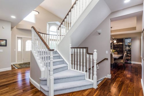 Staircase in vaulted ceiling with hardwood floors at 619 Crescent Boulevard SW.