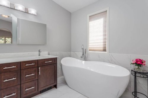 Artistic soaker tub and vanity with marble surround at 619 Crescent Boulevard SW.