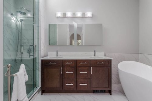 Luxury ensuite bathroom with steam shower and tub with dual vanity.