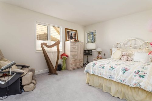 Bedroom with harp at 619 Crescent Blvd Elboya Calgary home for sale by Plintz Real Estate