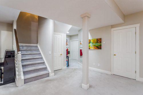 walkout basement staircase in Elboya home