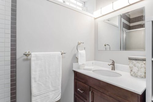 bathroom with wood vanity and quartz countertop