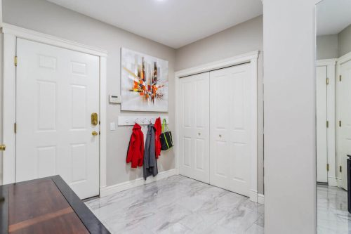 marble tile foyer and mudroom in luxury home