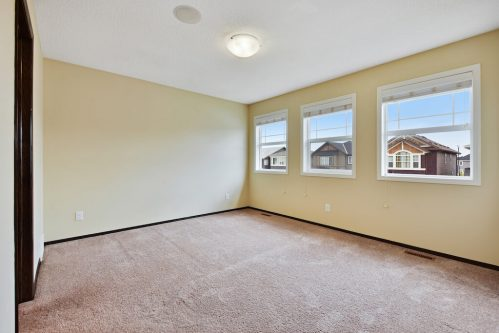Master bedroom with large windows 119 Evansborough Crescent NW Calgary Home For Sale Plintz Real Estate