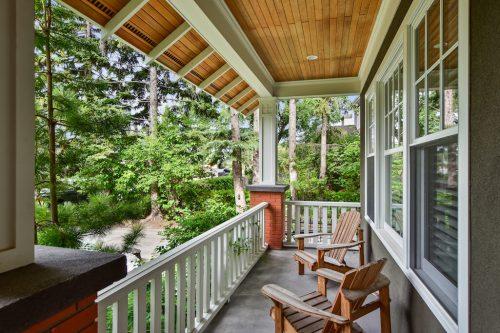Muskoka chairs on front veranda of Mount Royal Calgary Home