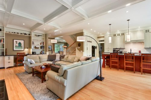 Open concept living room with coffered ceilings