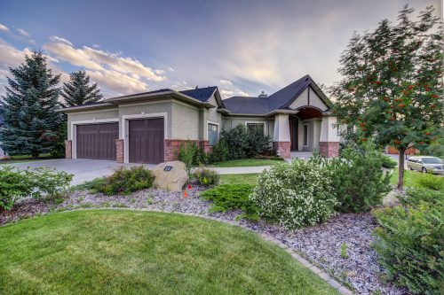 Triple garage and beautiful front yard landscaping at 11 Spring Valley Mews Luxury Home For Sale by Realtor Dennis Plintz