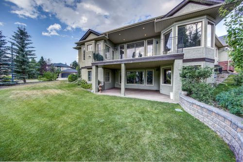 Walkout bungalow with large deck and covered patio at 11 Spring Valley Mews Luxury Home For Sale in Calgary