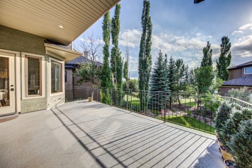 Large deck overlooking the trees in Sprinkbank Hill Calgary