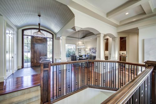 Front foyer with barrel ceiling and dining room at 11 Spring Valley Mews Luxury Home For Sale in Calgary By Plintz Real Estate
