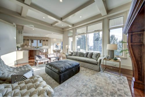 Open concept living room with floor-to-ceiling windows overlooking the southwest backyard at 11 Spring Valley Mews Luxury Home For Sale