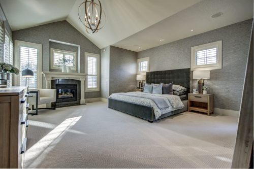 Vaulted ceiling and grasscloth wallpaper in master suite at 11 Spring Valley Mews Luxury Home For Sale in Calgary
