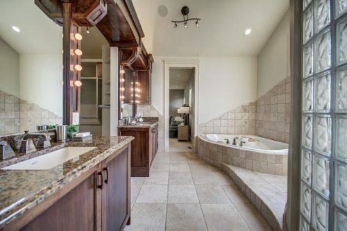 Master ensuite with dual vanities and corner soaker tub.