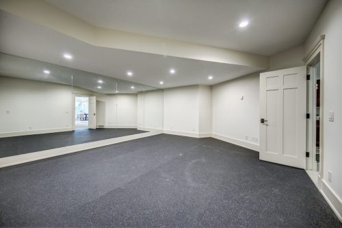Gym fitness exercise room with rubber floor and mirrors