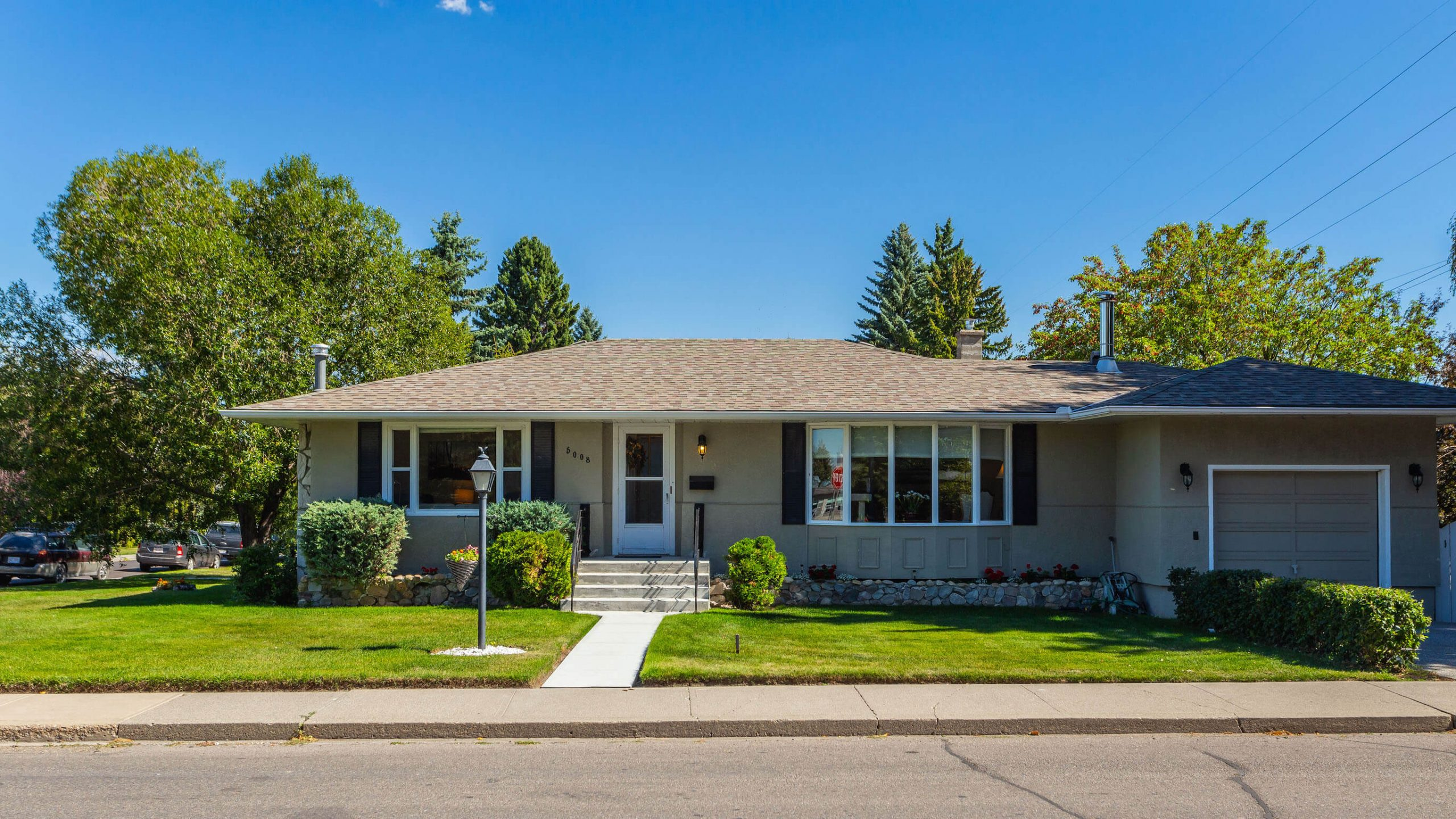 Bungalow on picturesque street in Elboya, Calgary. For sale by Plintz Real Estate.