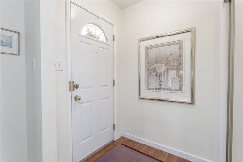 Entry foyer of home for sale by Realtor Dennis Plintz.