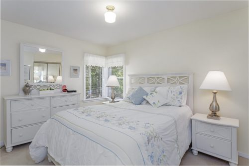 Charming master bedroom in Elboya home for sale.