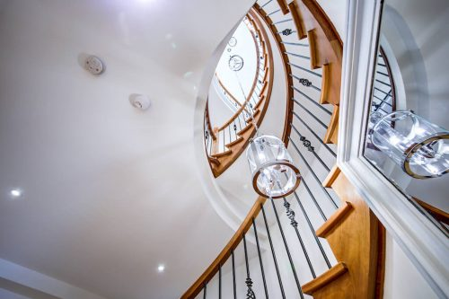 Spiral-Staircase-Chandelier-4615-Coronation-Drive-SW-Britannia-Calgary-Luxury-Home-For-Sale-Plintz-Real-Estate-
