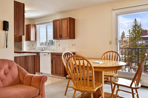 Dining and kitchen in bankview condo 102, 2508 17 Street SW for sale by Plintz Real Estate.