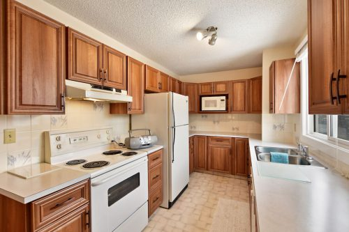 Condo kitchen at 102, 2508 12 Street SW for sale by Plintz Real Estate.