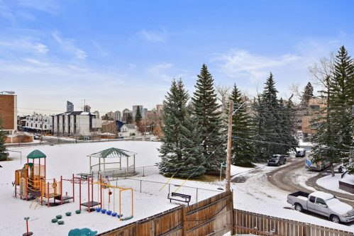 Balcony view from Bankview condo for sale in Calgary Alberta.