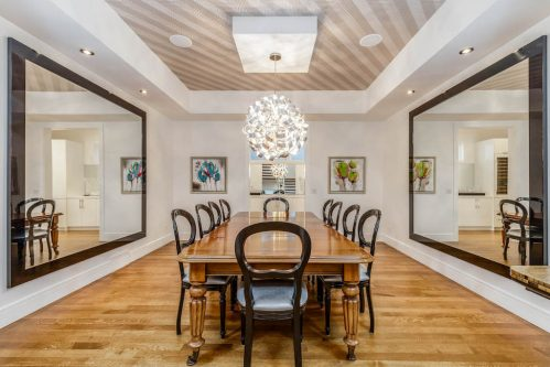 Formal dining room with tray ceiling in luxury home by Paul Lavoie at 416 Roxboro Road SW Calgary